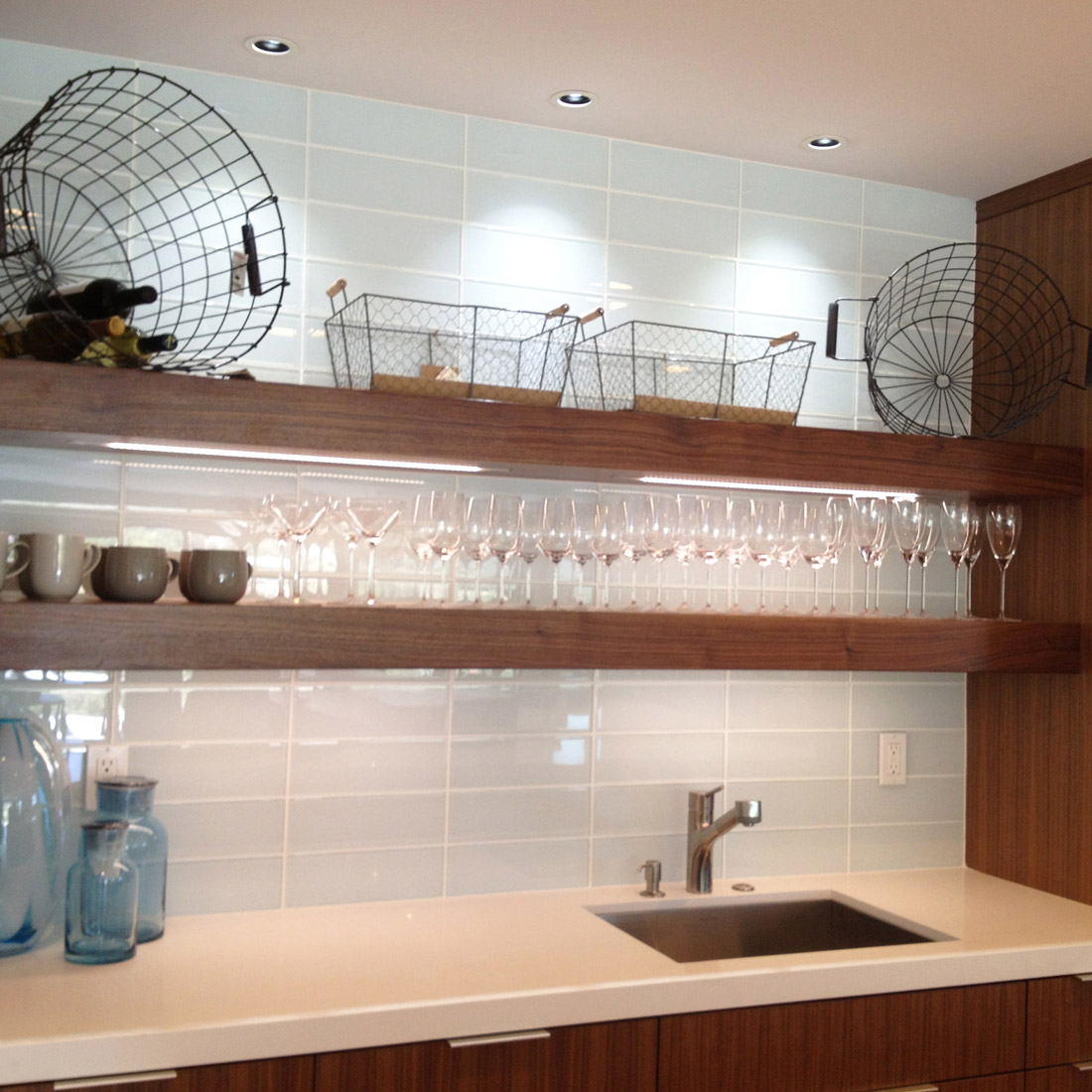 Modern Kitchen Remodel With Walnut Open Shelves And Large Format Glass Tile  Backsplash Display Glassware Above ...