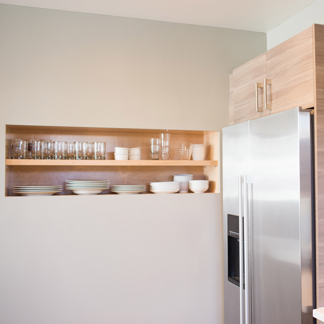 modern kitchen remodel with built in open shelves to display dishes design by sara bates interior design