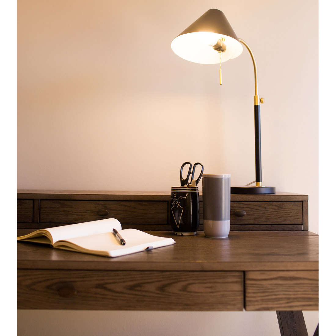 simple modern desk with black and brass lamp design by sara bates interior design