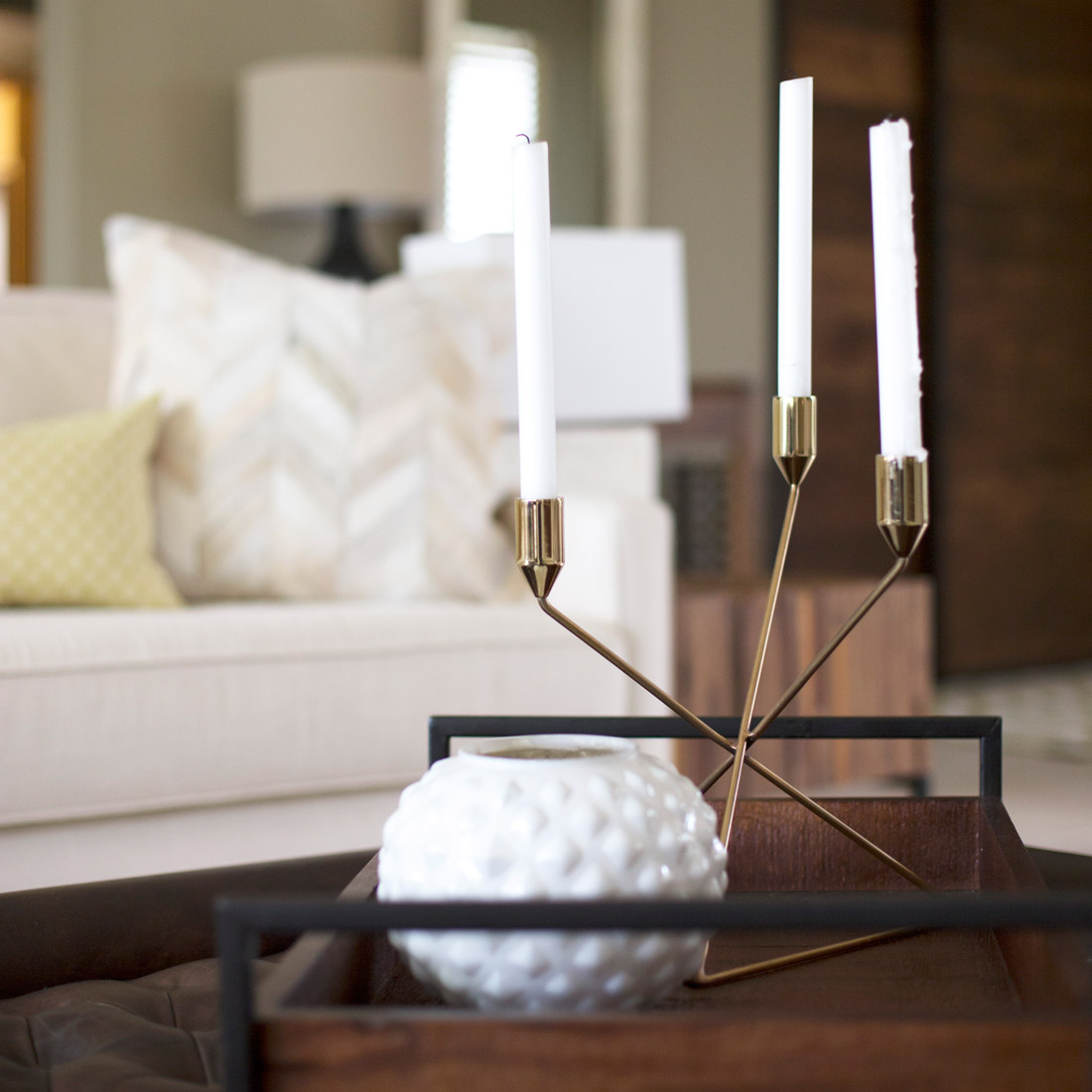 coffee table tray with white milk glass vase and brass candle holder design by sara bates interior design