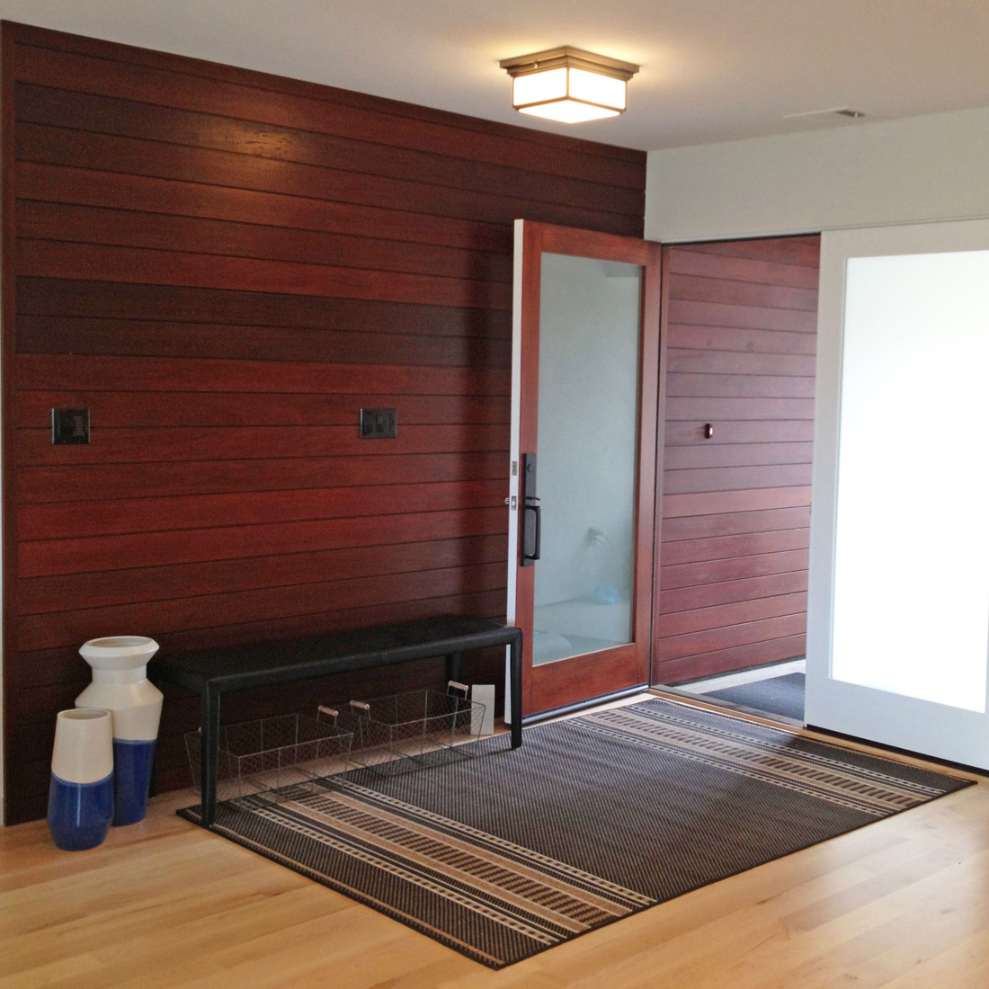 Superior ... Ipe Wood Paneling Entryway Modern French Doors With Black Leather Bench  And Natural Light Oak Floors ...