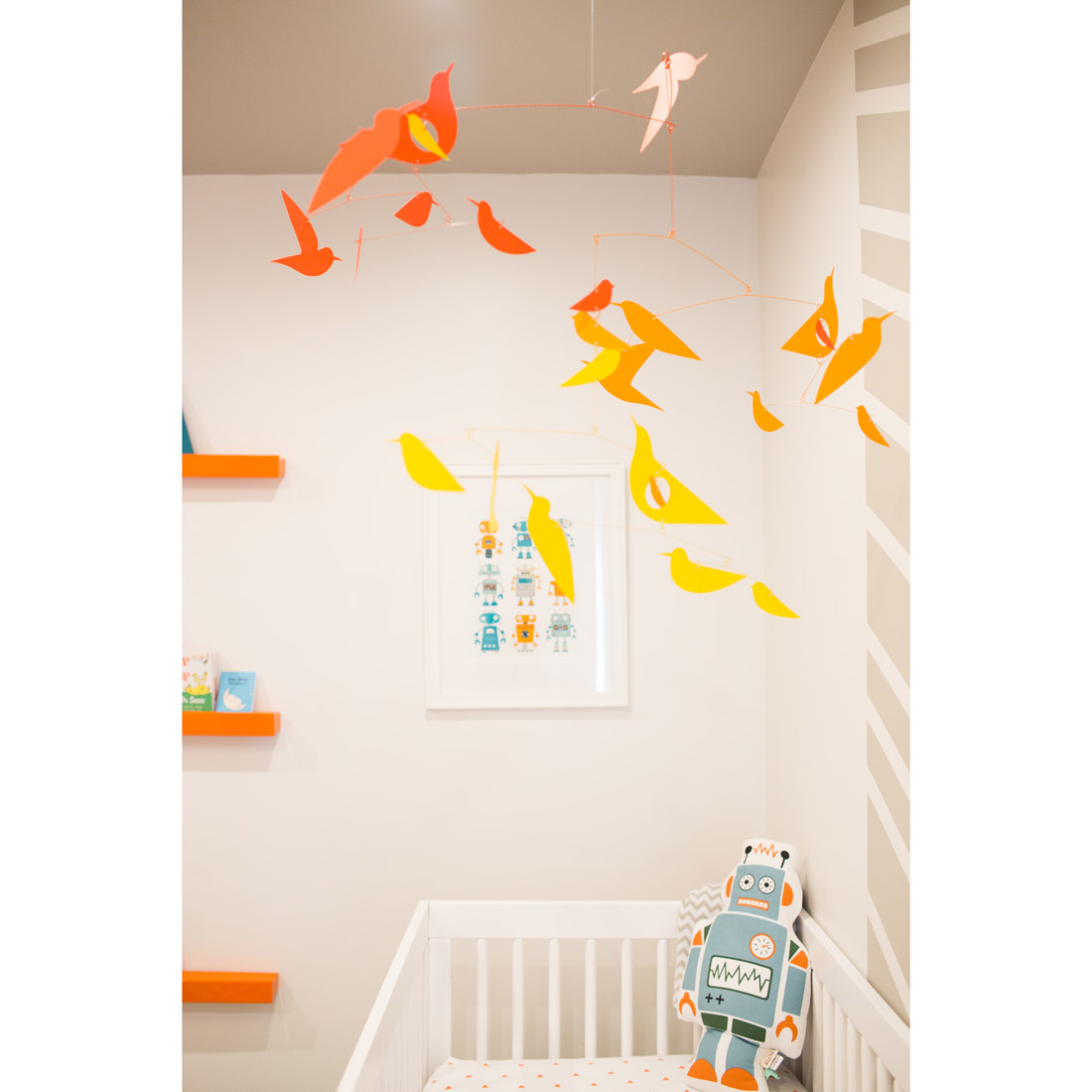 nursery with robot decor and wall art with a moma bird mobile design by sara bates interior design