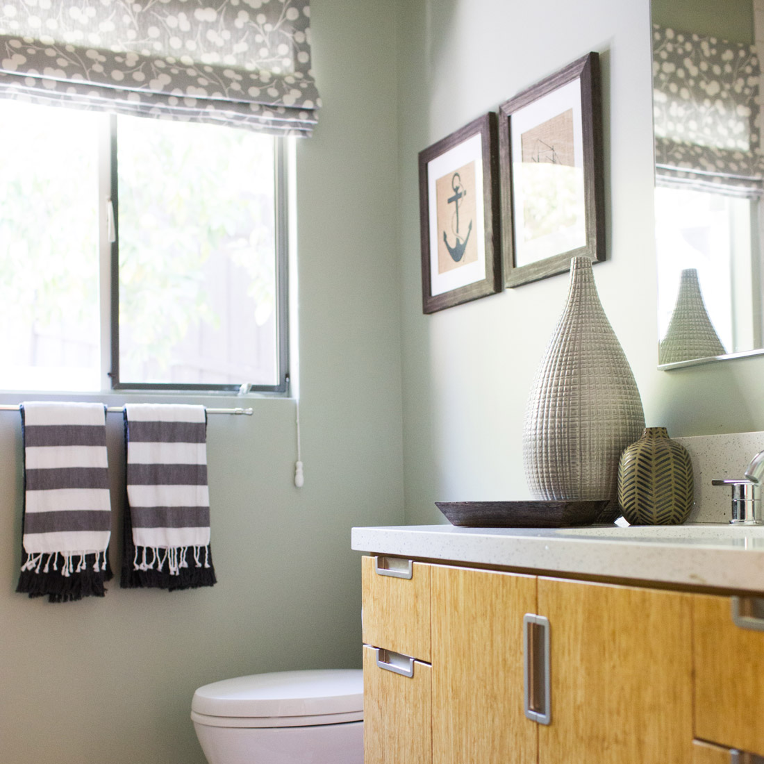 guest bathroom with bamboo vanity and whimsical roman shades design by sara bates interior design