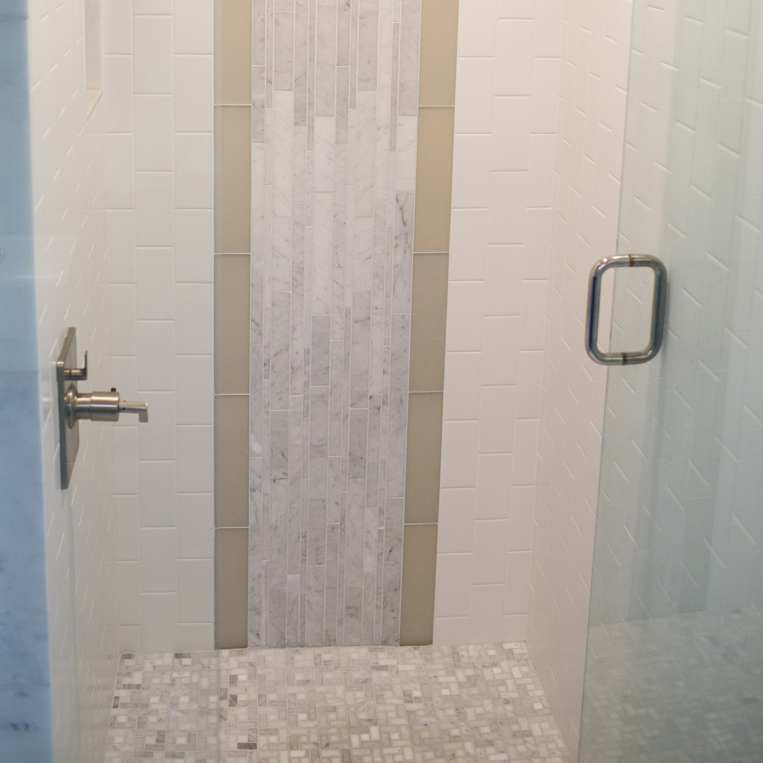 marble and glass tile pattern in master bathroom shower design by sara bates interior design
