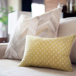 pillow design with chevron cowhide pattern and small lumbar pillow in chartreuse green design by sara bates interior design
