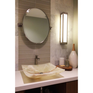guest bathroom remodel with onyx vessel sink on white ceasarstone counterop with glass and marble tile pattern backsplash and oval vanity mirror design by sara bates interior design