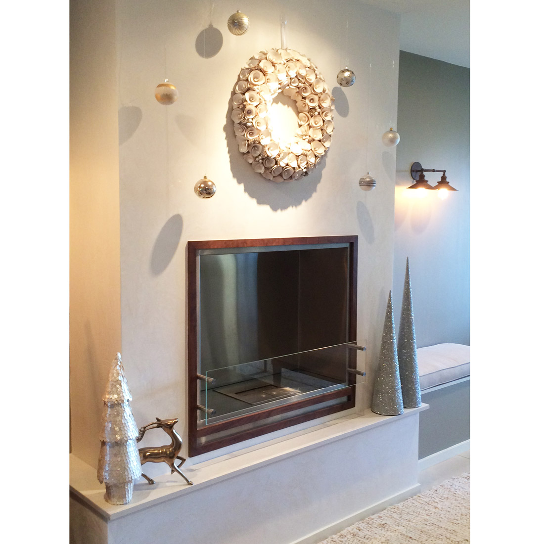 holiday wreath and decor adorn a venetian plaster white modern fireplace design by sara bates interior design