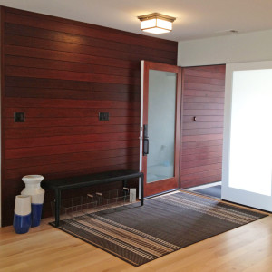 ipe wood paneling entryway modern french doors with black leather bench and natural light oak floors design by sara bates interior design