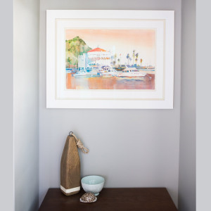seaside beachy entryway with watercolor artwork of catalina island and table top decor design by sara bates interior design