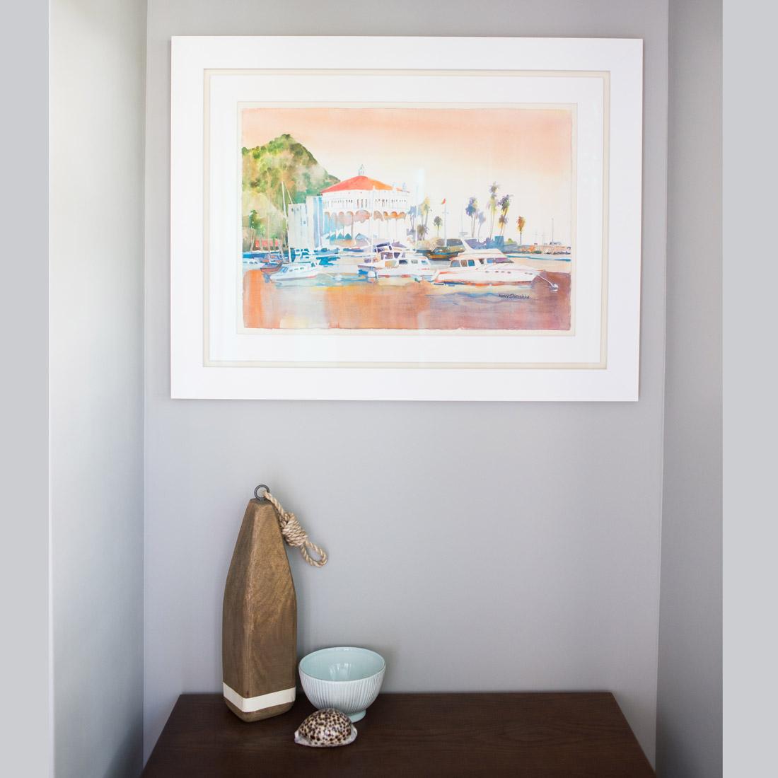 seaside beachy entryway with watercolor artwork of catalina island and table top decor design by sara bates interior design